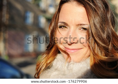 Outdoor portrait of beautiful young bride - stock photo