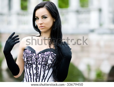 Outdoor portrait of beautiful young girl in stylish dress - stock photo