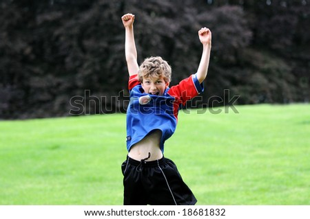 outdoor portrait of boy jumping - stock photo