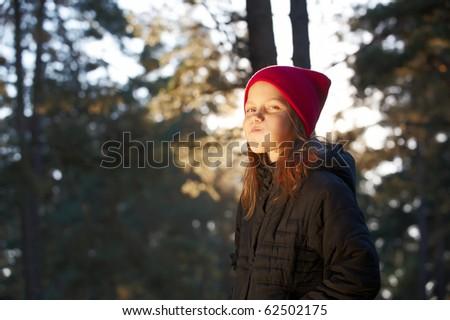 Outdoor portrait of cheerful little girl - stock photo