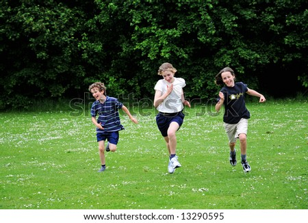 outdoor portrait of children running - stock photo