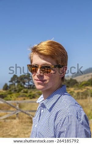 outdoor portrait of cool teenage boy with sunglasses - stock photo