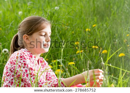 Outdoor portrait of cute little girl on the meadow - stock photo
