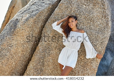 Outdoor portrait of gorgeous asian girl in white dress posing outdoor - stock photo
