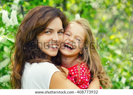 Outdoor portrait of mother and daughter