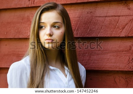 Outdoor portrait of pretty, young teen girl outdoors - stock photo