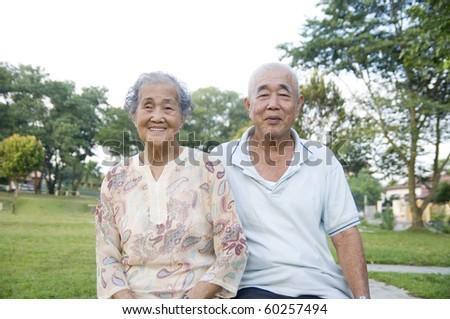 outdoor portrait of senior asian couple - stock photo