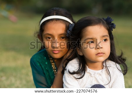 outdoor portrait of two little girls. - stock photo
