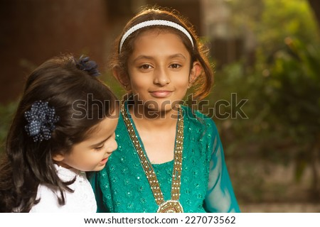 outdoor portrait of two little sisters, two girls - stock photo