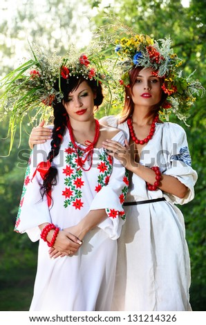 Outdoor portrait of two women in wreath - stock photo