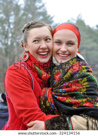 outdoor portrait of two young ukrainian women in traditional ukrainian clothes - stock photo