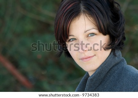 outdoor portrait of young attractive woman