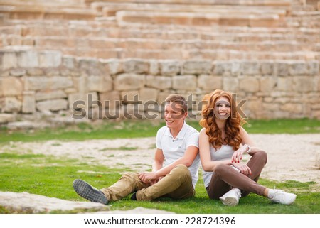 Outdoor Portrait of young couple in summer. happy young couple in love outdoor in spring.  - stock photo