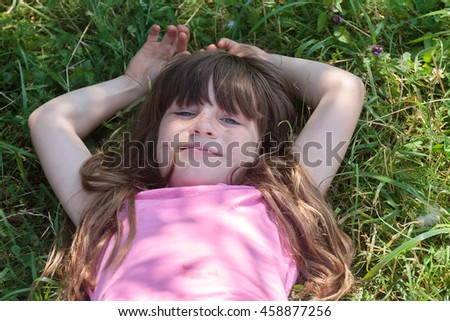 outdoor portrait of young smiling child girl on natural background - stock photo