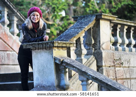 Outdoor Portrait Of Young Woman On Steps - stock photo