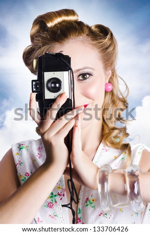 Outdoor portrait photographer taking old film snaps with 1950s vintage camera - stock photo
