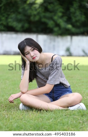 outdoor portrait two asian girl  with  perfect smile  at the park