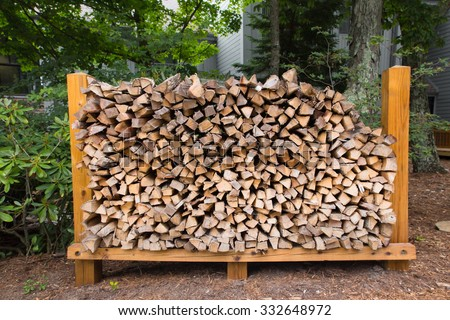 Outdoor rack with firewood logs - stock photo