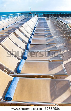 outdoor relaxation area on stern of cruise liner - stock photo