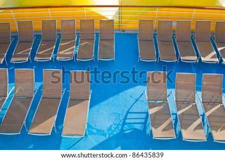 outdoor relaxation deck on stern of cruise liner - stock photo