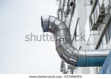 outdoor restaurant air pipe kitchen airduct for ventilate smoke and vacuum odor. - stock photo