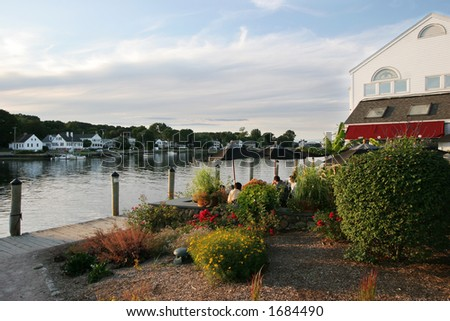 outdoor restaurant along river in Mystic, Connecticut - stock photo