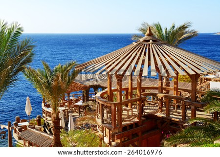 Outdoor restaurant and beach at the luxury hotel, Sharm el Sheikh, Egypt - stock photo