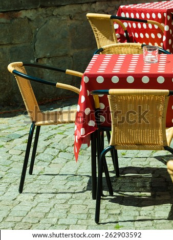 Outdoor restaurant coffee terrace open air cafe chairs with table. Summer vacation on resort - stock photo