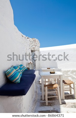 Outdoor restaurant tables with blue sky in Mykonos, Greece
