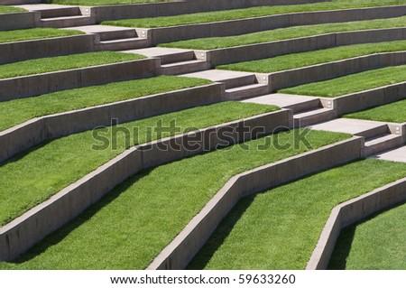 outdoor seating area - sunny grassy empty seats - stock photo