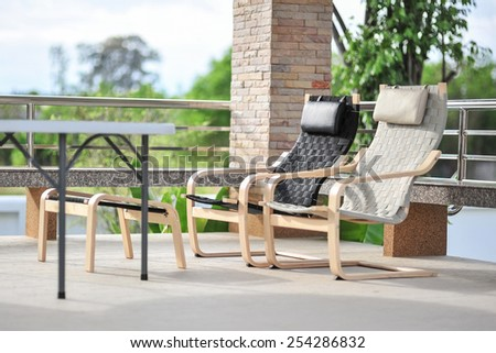 Outdoor seating area with Rattan sofa - stock photo