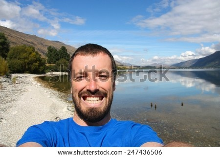 Outdoor selfie photo from Lake Wakatipu, New Zealand. - stock photo