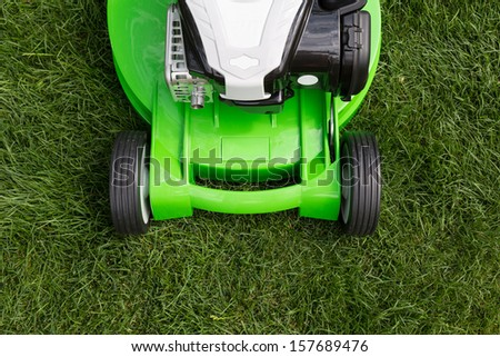 Outdoor shot of green lawnmower