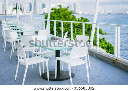 Outdoor sitting in miami restaurant - stock photo