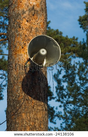 outdoor speaker hanging on the tree