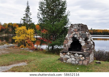 Outdoor Stone Fireplace Located On The Lake. Autumn, Ontario, Canada