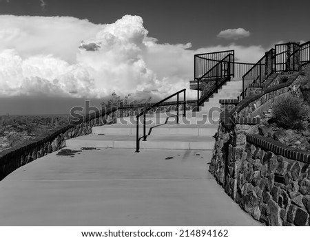 Outdoor stone stairs with storm clouds in background
