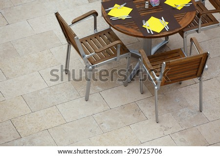 Outdoor summer cafe tables with chairs. View from above. Copy space