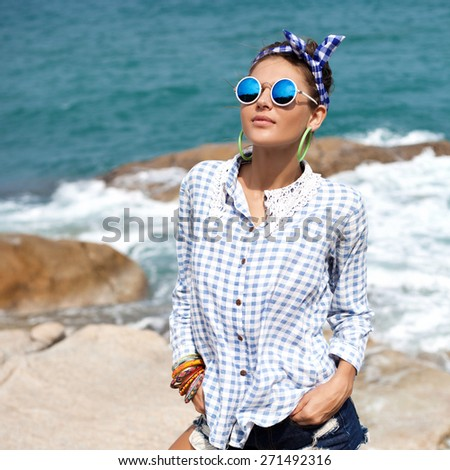 Outdoor summer fashion hipster sexy hot sensual portrait of young blonde beautiful woman having fun on the seashore of tropic island on vacation - stock photo