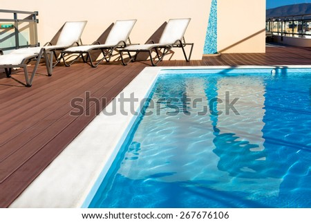 Outdoor swimming pool at a house roof. Horizontal shot