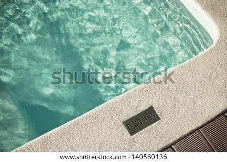 Outdoor Swimming pool with sunlight and shadows - stock photo