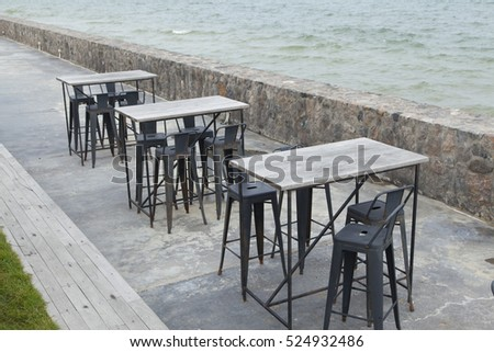 Outdoor table and chair at terrace by the sea