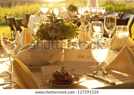 outdoor table setting at wedding reception - stock photo
