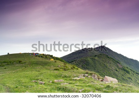 outdoor tent on the mountaintop in the morning - stock photo