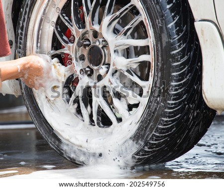 Outdoor tire car wash with sponge. - stock photo
