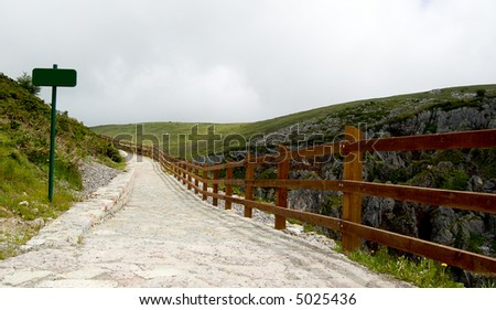 Outdoor track with sign template and wooden fence