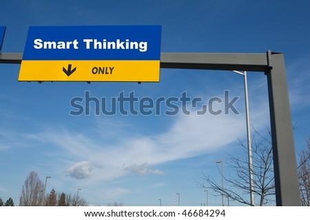 Outdoor traffic billboard the word smart thinking on it - stock photo