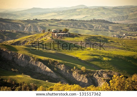 Outdoor Tuscan gold hills landscape at sunset. Horizontal shot
