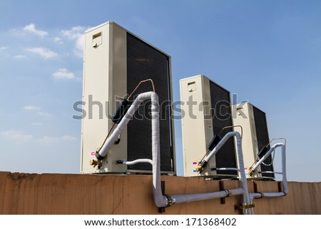 Outdoor Unit of Air Conditioner with blue sky. - stock photo