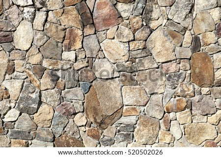 Outdoor Wall Made of Uneven Stones